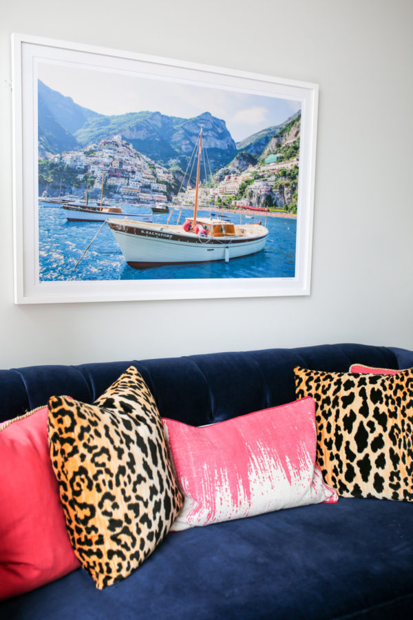 Bows & Sequins custom navy velvet Society Social couch with pink and leopard throw pillows and framed Gray Malin Italy print.