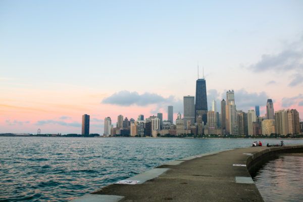 Sunrise over Lake Michigan with the Chicago city skyline.