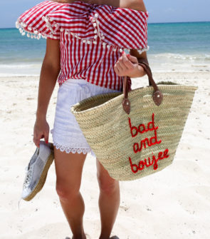 Chicago-based fashion and lifestyle blogger Bows & Sequins wearing a red gingham off the shoulder top with a Bad and Boujee straw tote in Mexico.