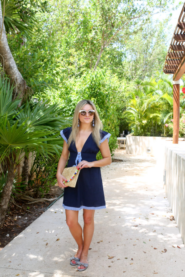 Bows & Sequins wearing a tie-front navy Sail to Sable swimsuit cover up in Mexico.