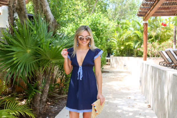 Jessica of Bows & Sequins, a Chicago-based fashion-focused blog, wearing a navy Sail to Sable bikini cover up at the Fairmont Mayakoba resort in Mexico.
