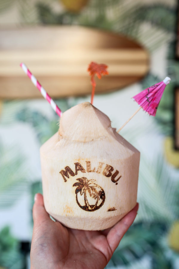 A Malibu Rum coconut cocktail with a striped straw and paper umbrella at Tiki Tabu in NYC