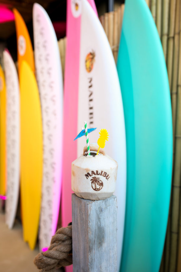 Colorful surf boards and a coconut cocktail by Malibu Rum at the summer kick off party in NYC at Tiki Tabu in the Sixty LES hotel.