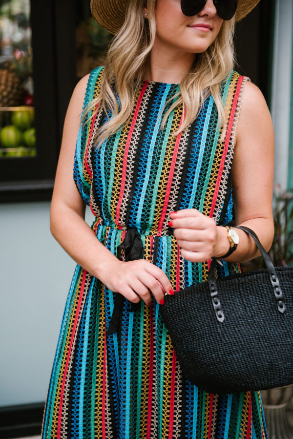 0e037319694 Chicago blogger Bows & Sequins wearing a rainbow striped Eva Franco dress  from Anthropologie with a