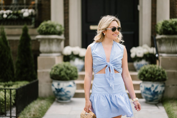 Chicago blogger Bows & Sequins wearing a front tie crop top and ruffled drop waist skirt from Fame & Partners for summer.
