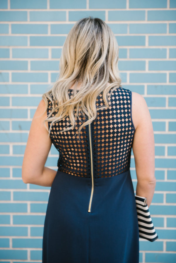 Bows & Sequins wearing a navy backless Sail to Sable dress.