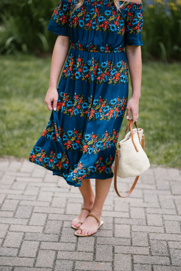 Fashion blogger Bows & Sequins wearing a floral dress from Old Navy with a Clare V Petit Kenya handbag and handmade Italian leather sandals.