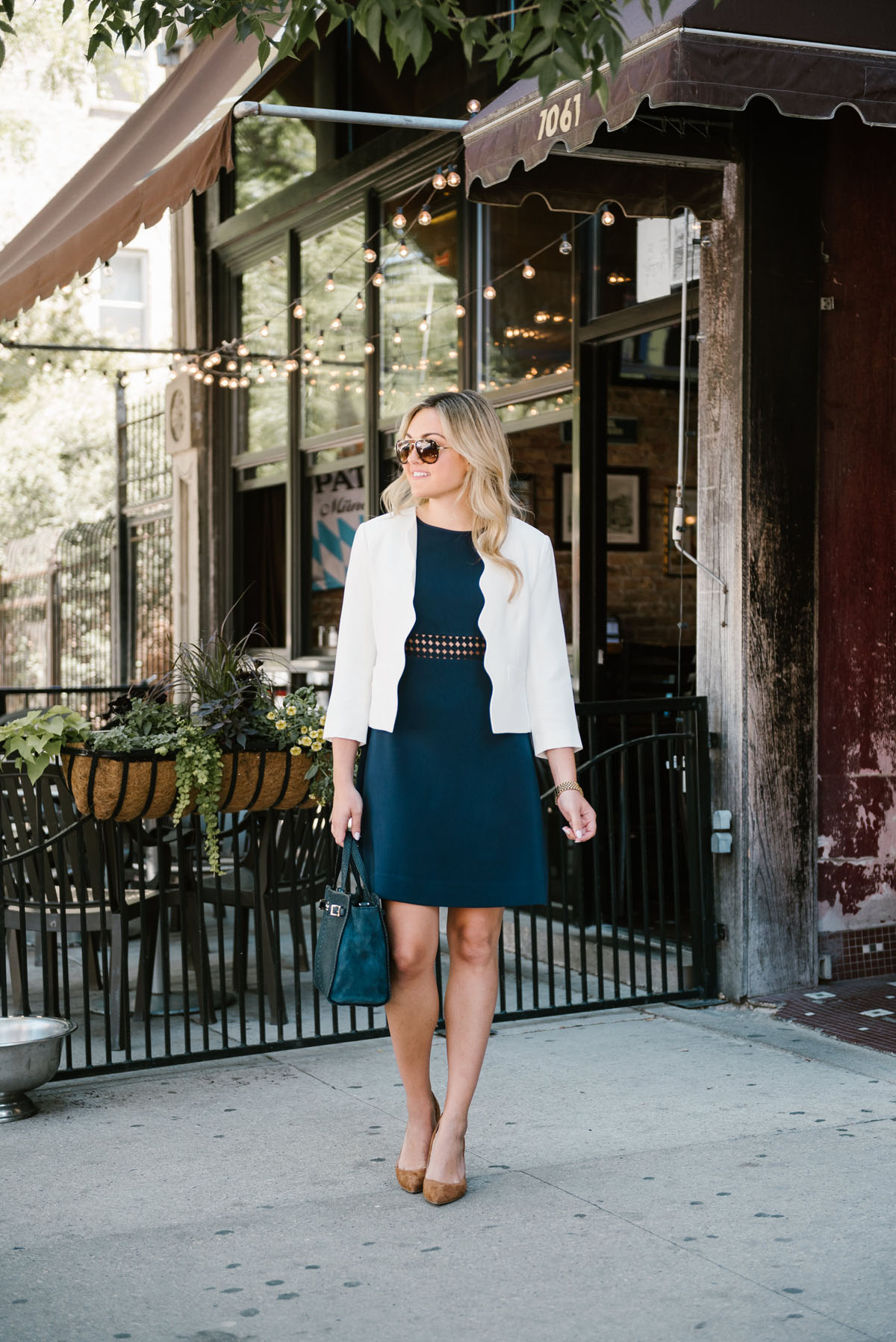 Bows & Sequins, a Chicago-based fashion blogger, wearing a Sail to Sable summer dress, Celine aviators, point-toe pumps, and a Draper James blazer for work.