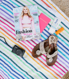 Chicago-based travel blogger Bows & Sequins shares her beach must-haves: Las Bayadas striped beach blanket, Jack Rogers sandals, a Canon video camera, SPF, Fresh Sugar Sport, and InStyle magazine.