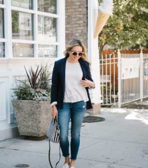 Bows & Sequins wearing a casual work outfit: knit blazer, peplum tee, raw hem skinny jeans, woven leather loafers with a striped crossbody bag.