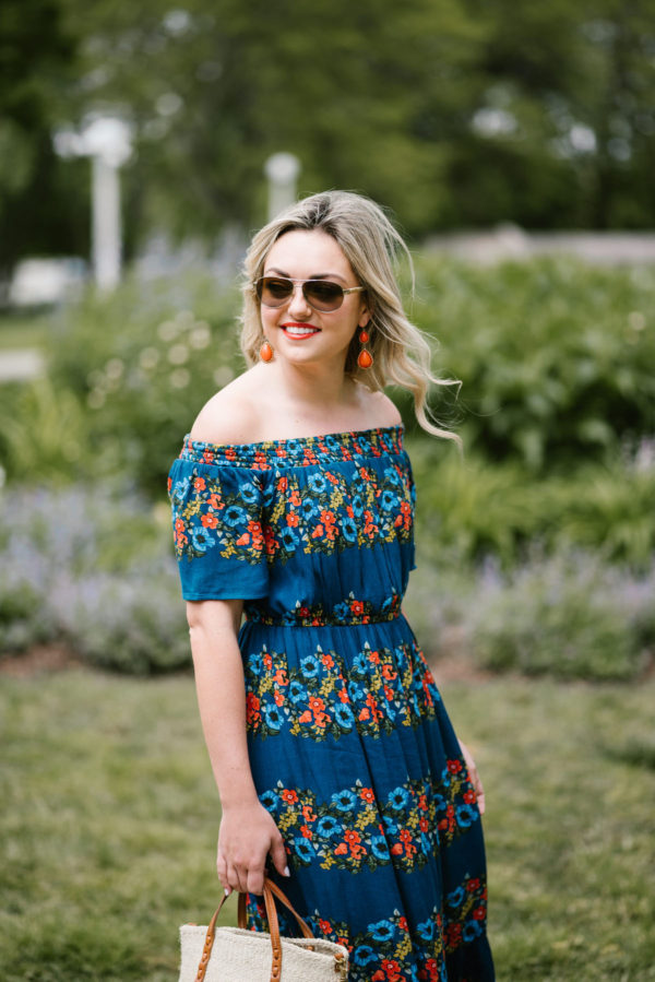 Bows & Sequins, Chicago lifestyle blogger, wearing Ralph Lauren aviators, orange statement earrings, and an off the shoulder floral dress.