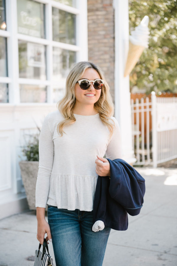 Chicago blogger Bows & Sequins wearing an Old Navy ruffle peplum tee with Illesteva sunglasses.