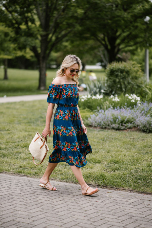 Bows & Sequins wearing an Old Navy off the shoulder floral dress with custom Italian sandals, a straw bag from Clare V, and Ralph Lauren aviators.