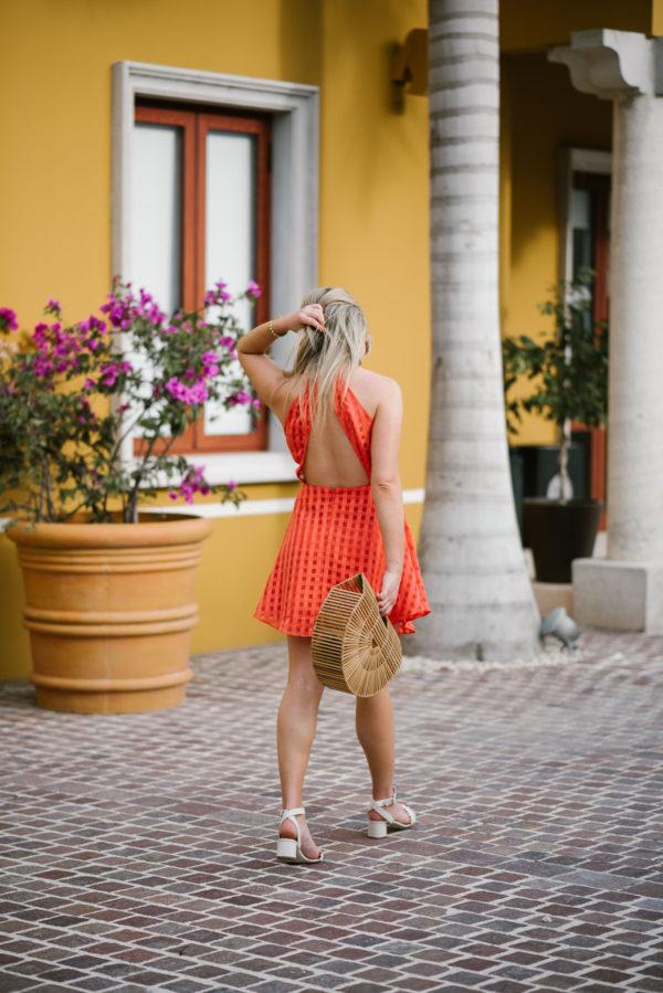 Bows & Sequins wearing a Lovers + Friends backless dress at the Fairmont Mayakoba Riviera Maya Mexico.