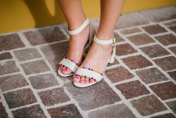 Bows & Sequins wearing J.Crew colorful pom pom sandals.