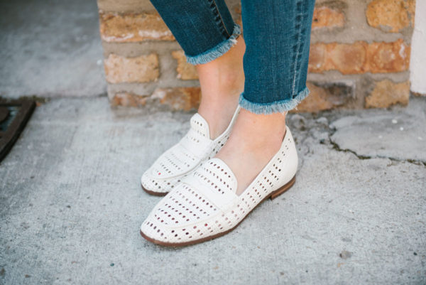 Bows & Sequins wearing raw hem skinny jeans and Sam Edelman woven leather loafers.