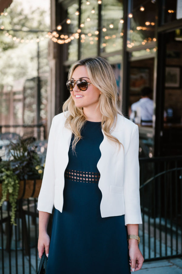 Bows & Sequins shares how to style a dress for summer work wear, with a navy Sail to Sable dress, a Draper James scalloped blazer, and Celine tortoise aviators.