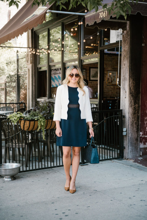 Bows & Sequins styling a Sail to Sable dress for work with a scalloped blazer, pointed toe pumps, and a Kate Spade bag.