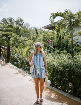 Lifestyle blogger Bows & Sequins wearing a nautical blue and white Vineyard Vines romper with a rope waist tie in Mexico.