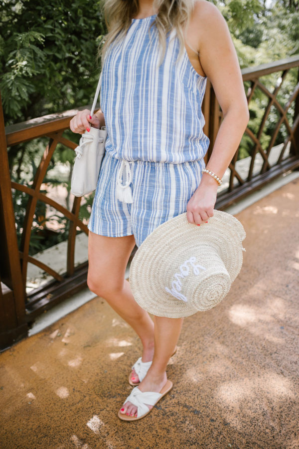 Bows & Sequins styling a nautical-inspired Vineyard Vines romper with a straw hat and white knotted slides in Mexico.