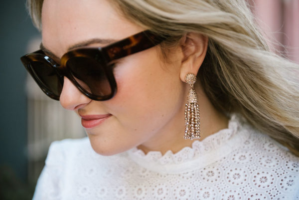 Chicago fashion blogger Bows & Sequins wearing Celine sunglasses and BaubleBar rose gold earrings.