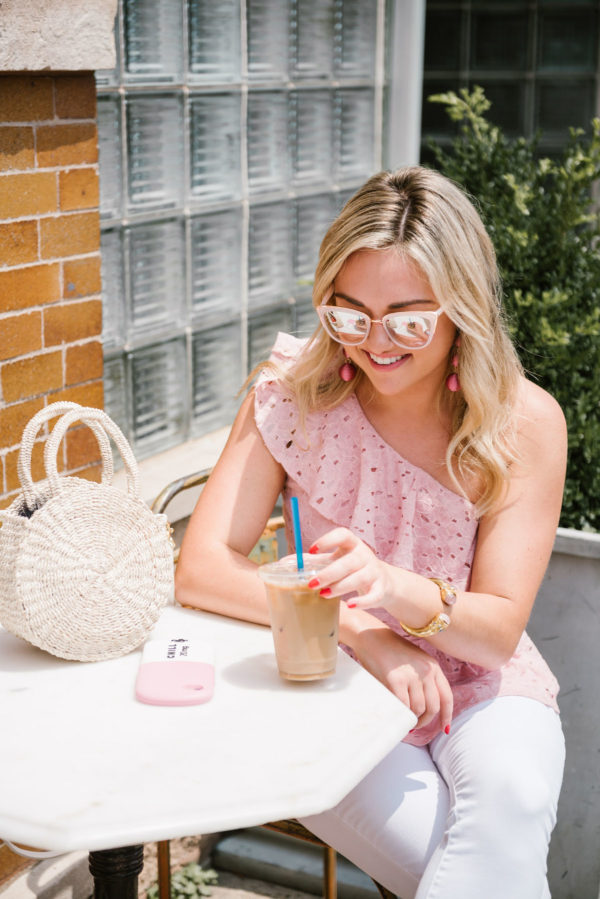 Chicago based fashion blogger Bows & Sequins wearing a J.O.A. pink peplum eyelet top with Nordstrom blush pink sunglasses and a Clare V straw bag.