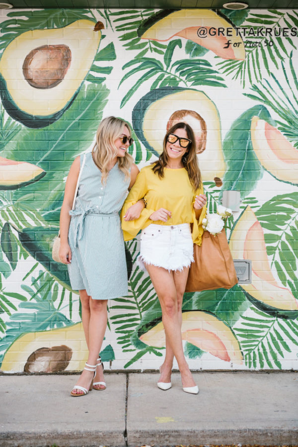 Jessica from the blog Bows & Sequins wearing a button down tie waist dress and Hallie Wilson of Among Other Things wearing a flare sleeve blouse and denim skirt.