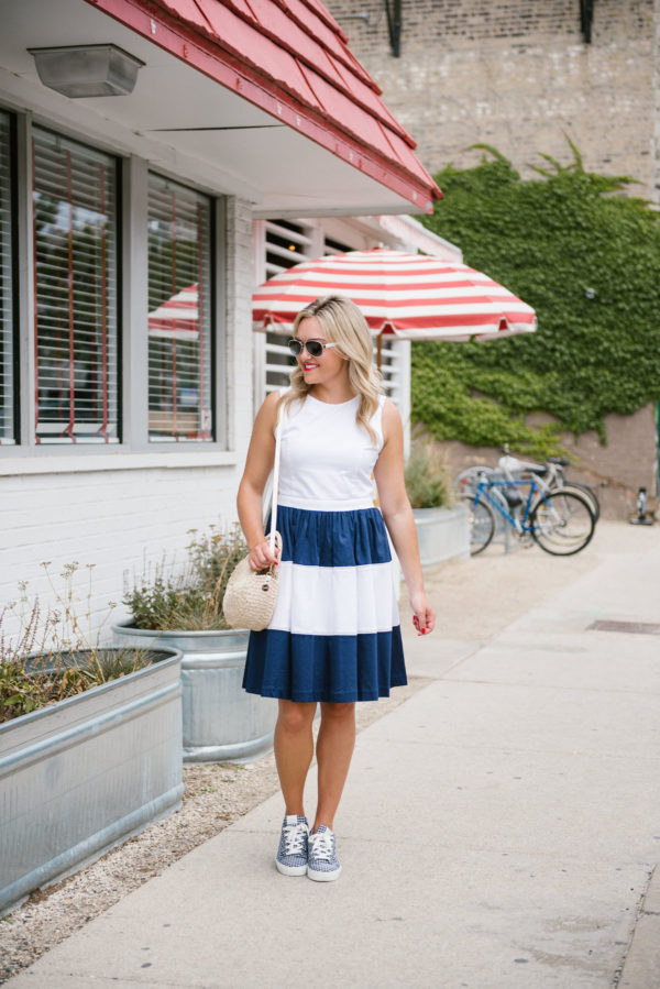 Bows & Sequins wearing a striped Elizabeth McKay dress with a Clare V straw satchel and Claudie Pierlot gingham sneakers.