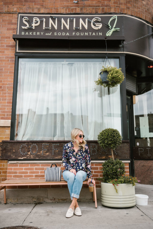 Bows & Sequins wearing cuffed straight leg jeans with a Rebecca Taylor floral blouse and Sam Edelman white loafers at the Spinning J coffee shop in Chicago.