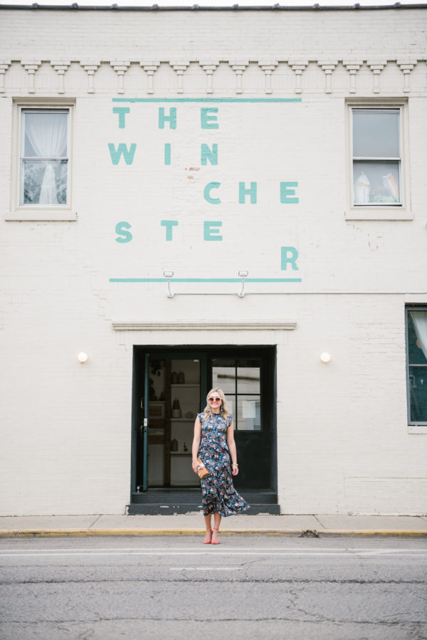 Bows & Sequins wearing a midi floral silk dress in front of the Winchester restaurant in Chicago.