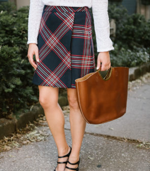 Bows & Sequins wearing a Halogen black plaid skirt, a Nat & Nin leather tote, and J.Crew Mary Janes.