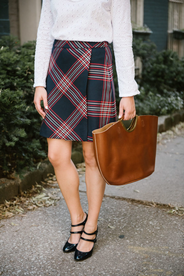 Bows & Sequins wearing a Halogen plaid skirt, a Nat & Nin leather tote, and J.Crew Mary Janes.