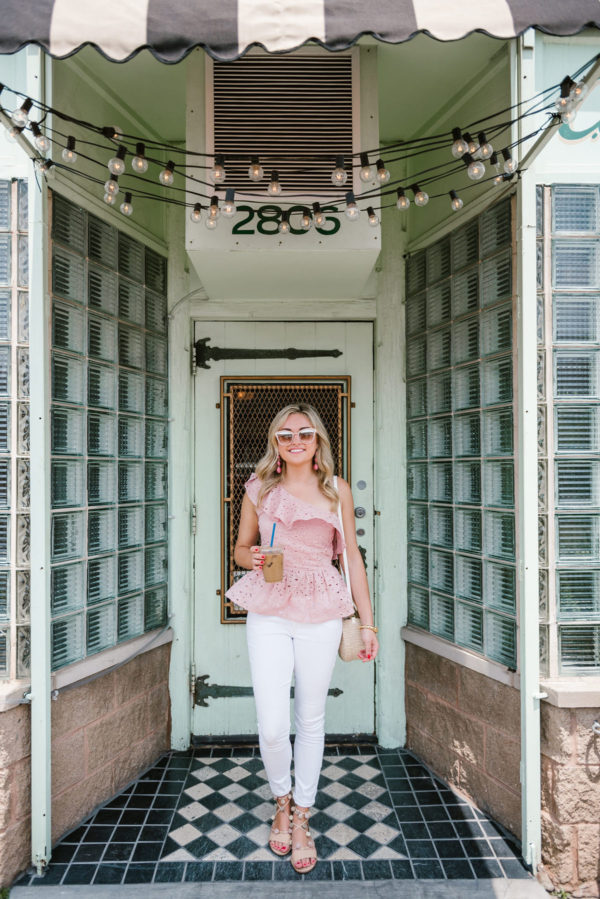 Chicago-based fashion blogger Bows & Sequins wearing a peplum top outfit at CC Ferns coffee shop: J.O.A. pink peplum top, Old Navy white denim jeans, Loeffler Randall pom pom sandals and a Clare V straw bag with Nordstrom blush pink sunglasses.