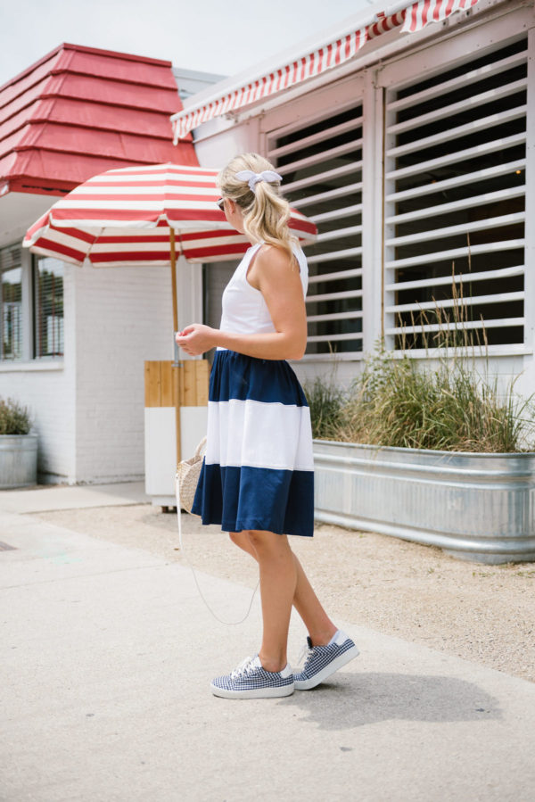 Bows & Sequins styling an Elizabeth McKay striped dress with navy gingham sneakers and a J.Crew eyelet hair bow.