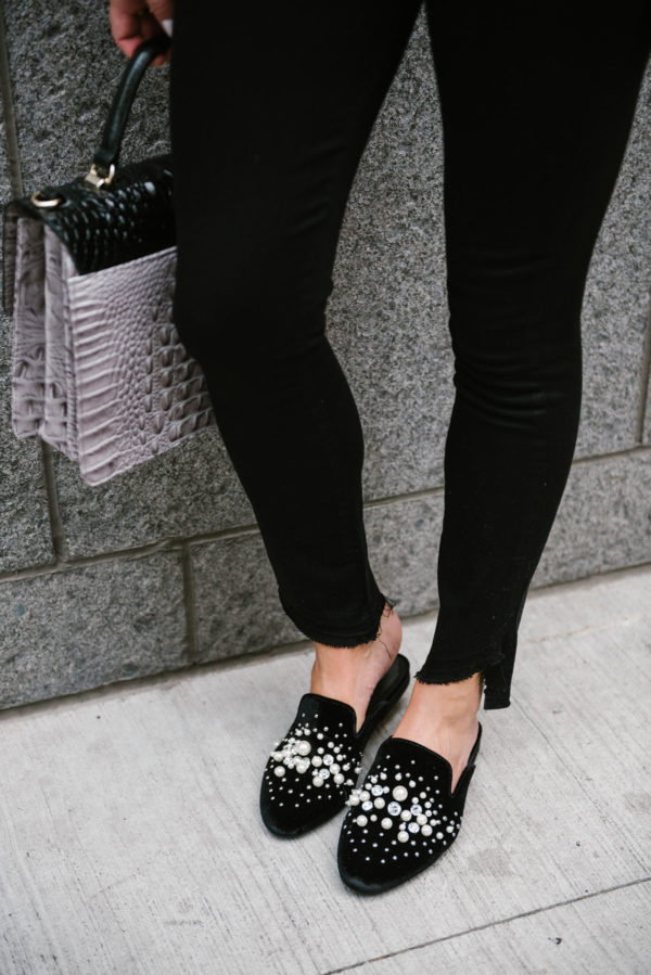 Chicago lifestyle blogger Bows & Sequins styling Steve Madden pearl slides with a Brahmin bag and raw hem Paige jeans.