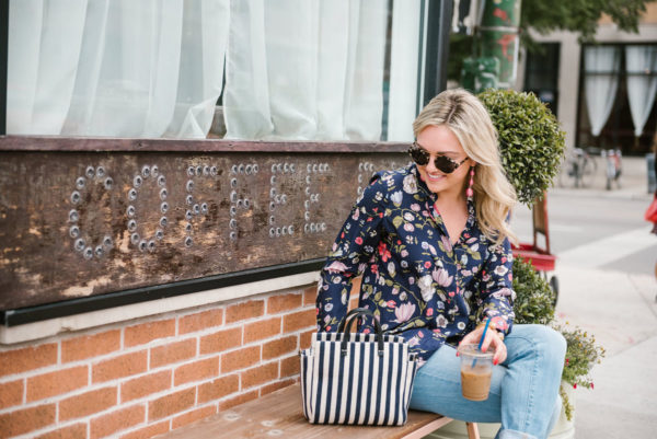 Bows & Sequins styling a Rebecca Taylor floral blouse with Illesteva sunglasses, pink BaubleBar Crispin drop earrings, a Julie Vos cuff, and a striped Clare V bag.
