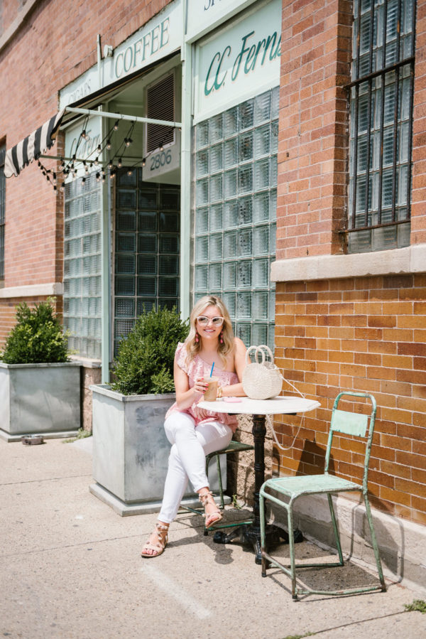 Bows & Sequins, a Chicago-based fashion blogger, wearing a summer peplum top, Old Navy white denim jeans, Nordstrom blush pink sunglasses, and Loeffler Randall pom pom sandals at CC Ferns.