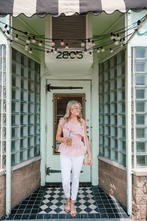 Chicago blogger Bows & Sequins wearing a J.O.A. pink eyelet top, Old Navy white denim jeans, pom pom sandals, and a Clare V straw bag.
