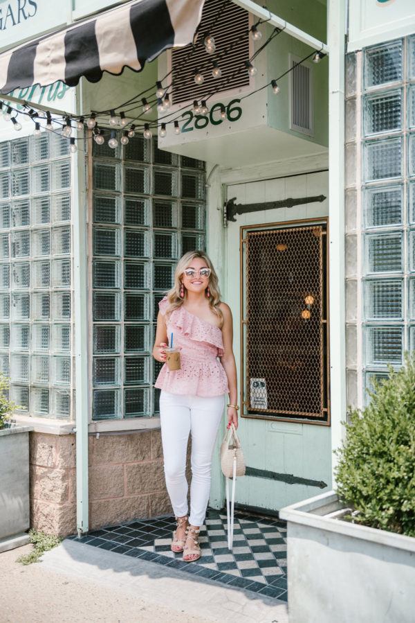 Chicago blogger Bows & Sequins wearing a J.O.A. pink eyelet top, Old Navy white denim jeans, pom pom sandals, and a Clare V straw bag at CC Ferns