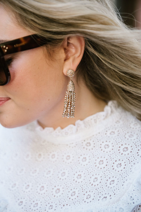 Bows & Sequins wearing BaubleBar rose gold tassel earrings.