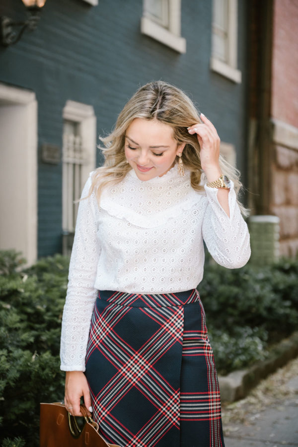 Fashion and lifestyle blogger Bows & Sequins styling a Sézane lace top with a Halogen plaid skirt for work.
