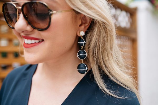 Bows & Sequins wearing Celine aviators, Dolce & Gabbana red lipstick, and navy nautical earrings from Baublebar.