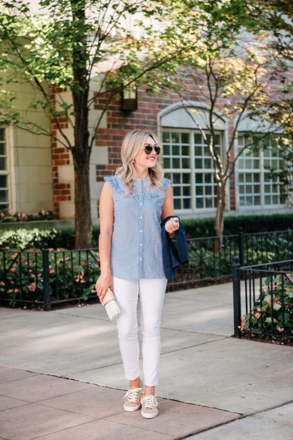 Chicago-based lifestyle blogger Bows & Sequins wearing Gucci aviators, a sleeveless chambray ruffle top, white denim jeans, and Old Navy leopard sneakers with a Julie Vos gold cuff.