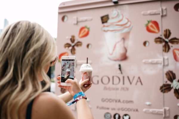 Bows & Sequins with Godiva Chocolate at the Lollapalooza music festival in Chicago.