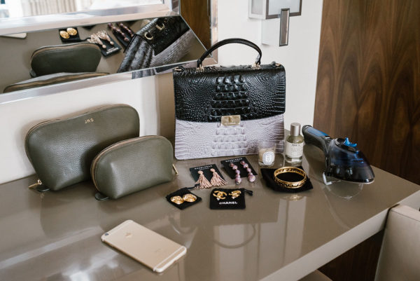 Fashion and travel blogger Cuyana travel bags, Brahmin bag, Chanel gold earrings, Rowenta travel steamer.
