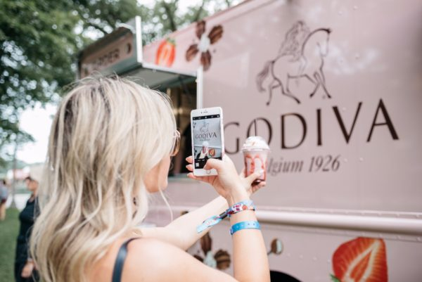 Bows & Sequins trying Godiva Chocolate's new Chocolixir drink at Lollapalooza in Chicago.