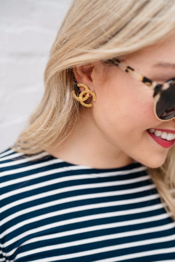 Chicago-based lifestyle blogger Bows & Sequins wearing gold Chanel earrings, Illesteva sunglasses, and Bare Minerals 'Juicy' matte lipstick.