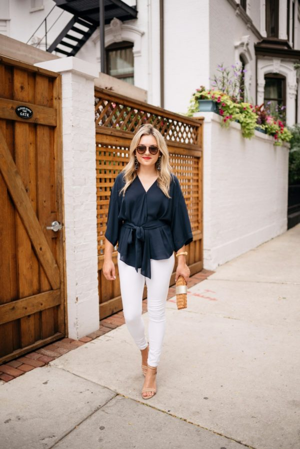 Travel and lifestyle blogger Bows & Sequins wearing Celine aviators, Baublebar nautical earrings, Dolce & Gabbana red lipstick, a navy Trouve blouse, and white denim from Old Navy.