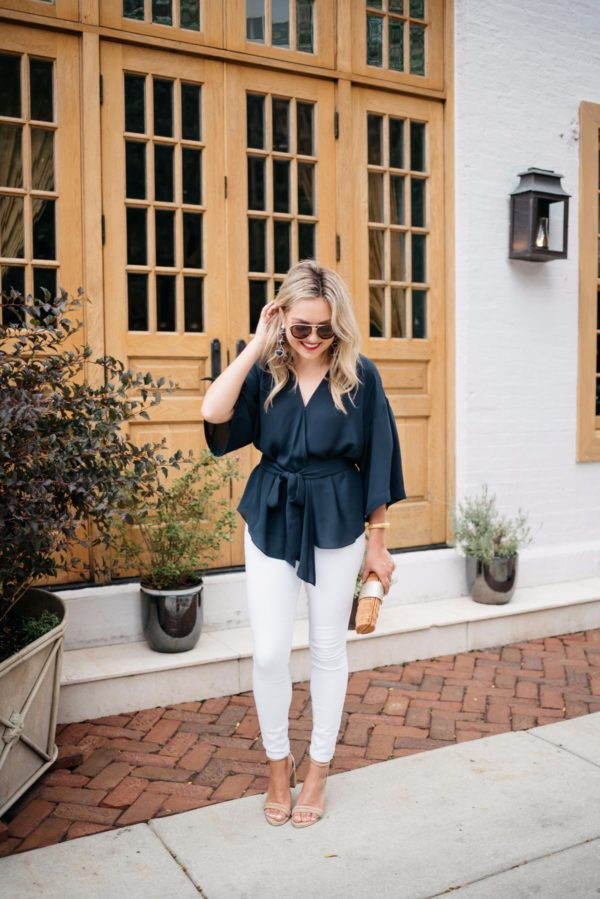 Bows & Sequins styling a navy Trouve blouse with white denim, Celine aviators, Kenneth Cole ankle strap heels, and a Vineyard Vines wicker clutch.