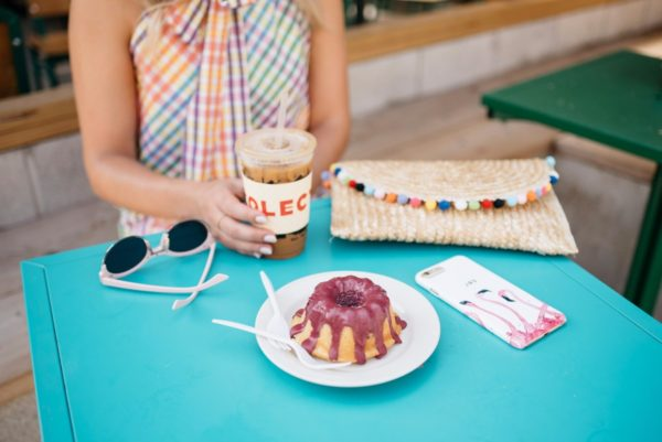 Bows & Sequins at Colectivo Coffee in Chicago with a White Elephant Designs pom pom clutch.